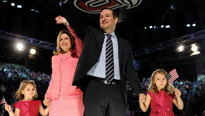 Sen. Ted Cruz, R-Texas,  waves with his wife, Heidi, and daughters, Catherine, left, and  Caroline, after  announcing his intention to run for president  Monday at Liberty University in Lynchburg, Va.