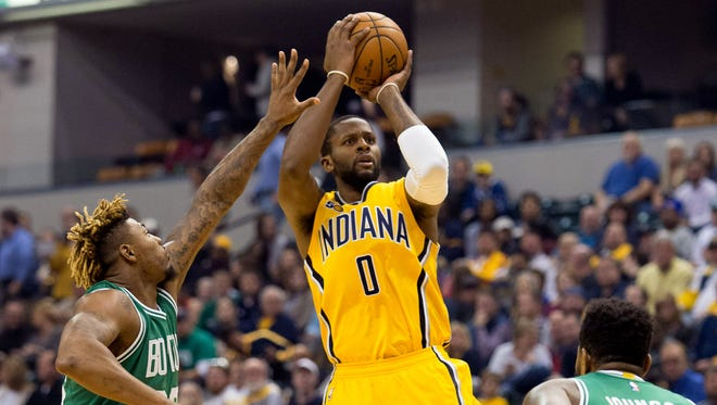 Nov 12, 2016; Indianapolis, IN, USA;  Indiana Pacers forward C.J. Miles (0) shoots the ball while Boston Celtics guard Marcus Smart (36) defends in the first quarter of the game at Bankers Life Fieldhouse.