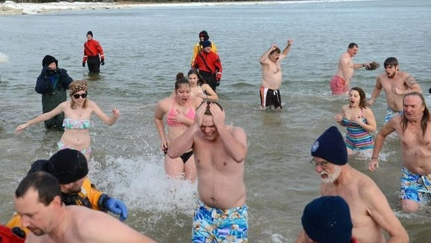during the 28th annual Jacksonport Polar Bear Plunge at Lakeside Park in Jacksonport, Wednesday, January 1, 2014.