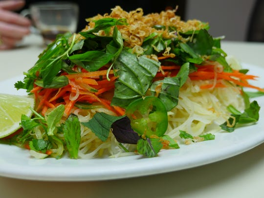 The green mango and papaya salad with carrots, jalapeno, basil and mint at the  Flowers of Vietnam pop-up inside Vernor Coney Island in Southwest Detroit on Sunday, March 13, 2016.