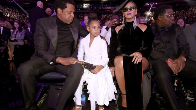 Jay-Z and Beyoncé with their daughter Blue Ivy at the 60th Annual Grammy Awards in New York on Jan. 28, 2018.