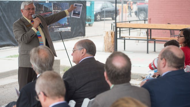Loveland Mayor Cecil Gutierrez speaks to a crowd during a groundbreaking ceremony for The Foundry, a mixed use space in downtown Loveland on Wednesday, July 12, 2017. The area, bordering Lincoln Avenue, First Street and Cleveland Avenue, will host a movie theater, hotel and other commercial space.