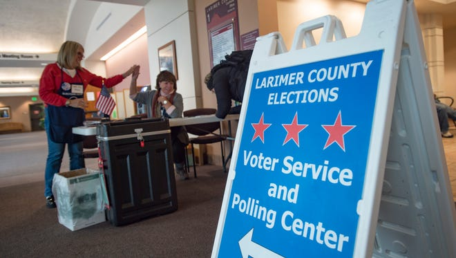 People drop off ballots and register to vote at the Larimer County Courthouse on Tuesday November 7, 2017.