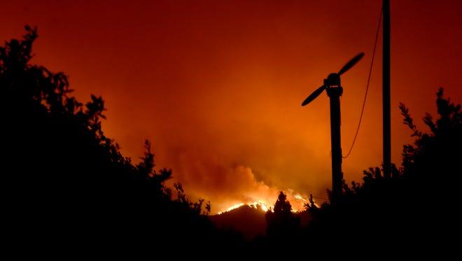The Thomas Fire burns in the hills above Santa Paula Dec. 4.