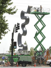 Artists Laura Haddad and Tom Drugan used guitar picks, LED lights, stainless steel and Ipe wood to create the 45-foot-high Light Meander. The sculpture will tower over the new West Riverfront Park, which is set to open in a few weeks.