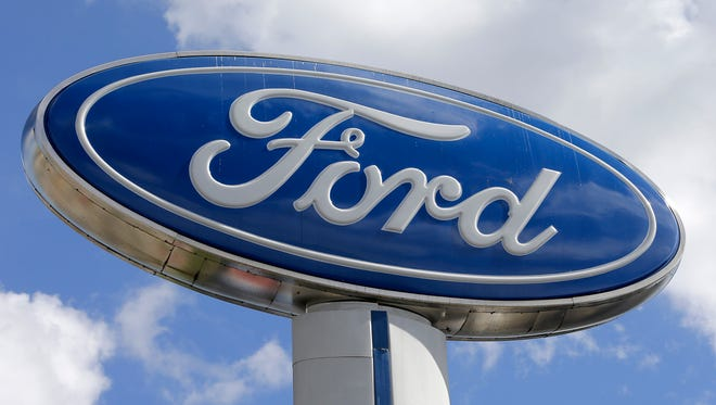 This Tuesday, Jan. 17, 2017, photo shows a Ford sign at an auto dealership in Hialeah, Fla.