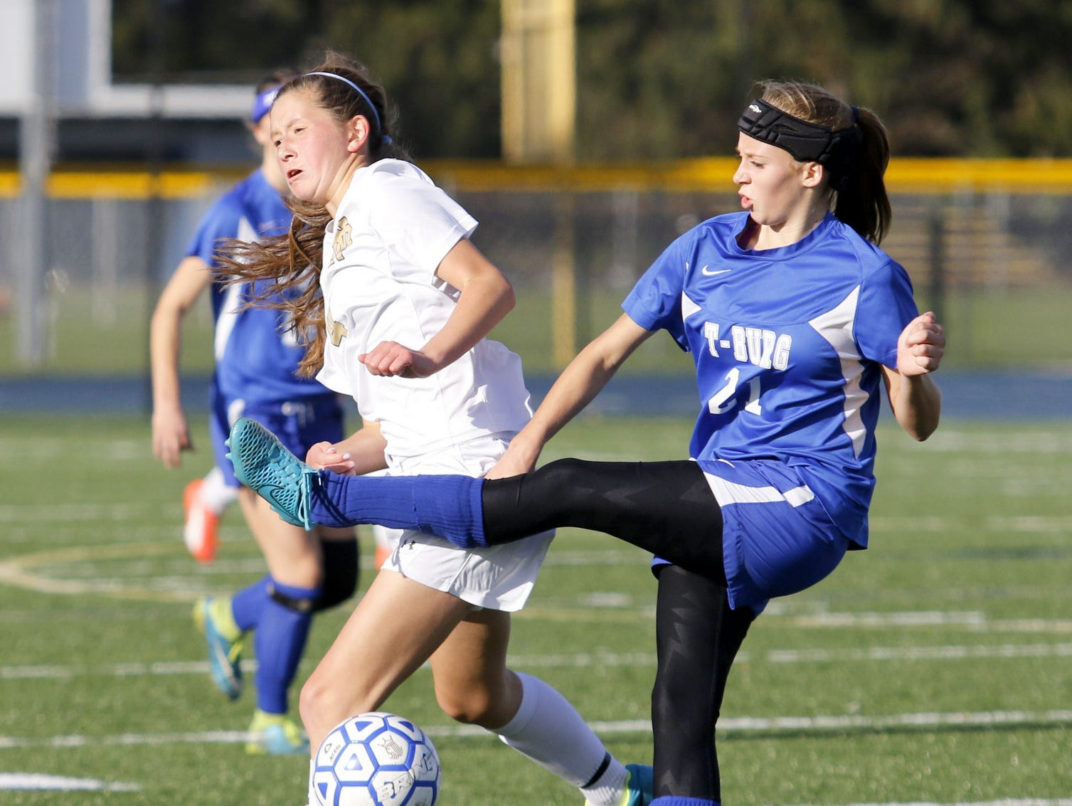 Notre Dame's Jillian Perrault, left, and Trumansburg's Tess Parker battle for the ball Tuesday during a Section 4 Class C girls soccer semifinal at Brewer Memorial Stadium.