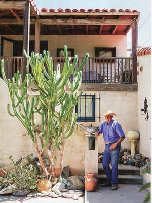 Clark Moorten in front of his family home that sits within the garden to lend its unique residential scale so appealing to Millennials.