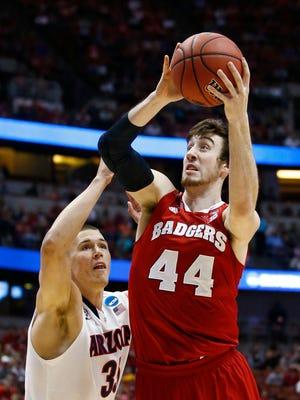 Wisconsin's Frank Kaminsky drives to the basket past Arizona's Kaleb Tarczewski in the NCAA West Regional Final on Saturday, Mar. 29, 2014 at the Honda Center in Anaheim.