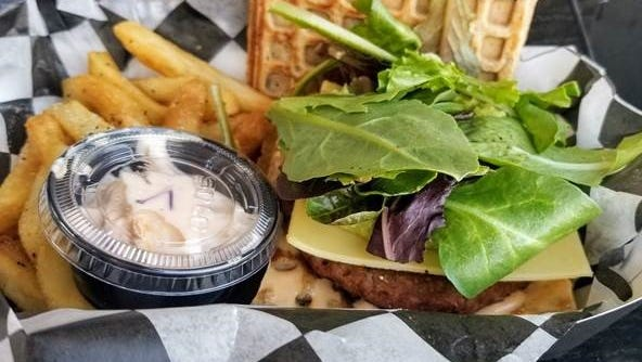 Beyond Burger with Golden Fries, field greens, Non-dairy cheese, and Vegan Sauce.