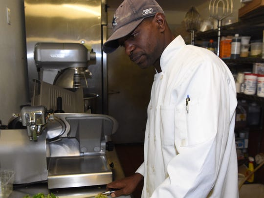 Rodrick Boney prepares some vegetables while working
