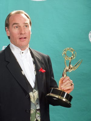 Actor Craig T. Nelson holds up his Emmy statuette at the 44th Annual Primetime Emmy Awards in Pasadena, Calif., in this Aug. 31, 1992 file photo. The NBC network said Thursday March 26, 2015 that it has ordered 13 episodes of a sequel to the 1989-97 ABC sitcom that starred Nelson as Hayden Fox, head coach of a college football team.