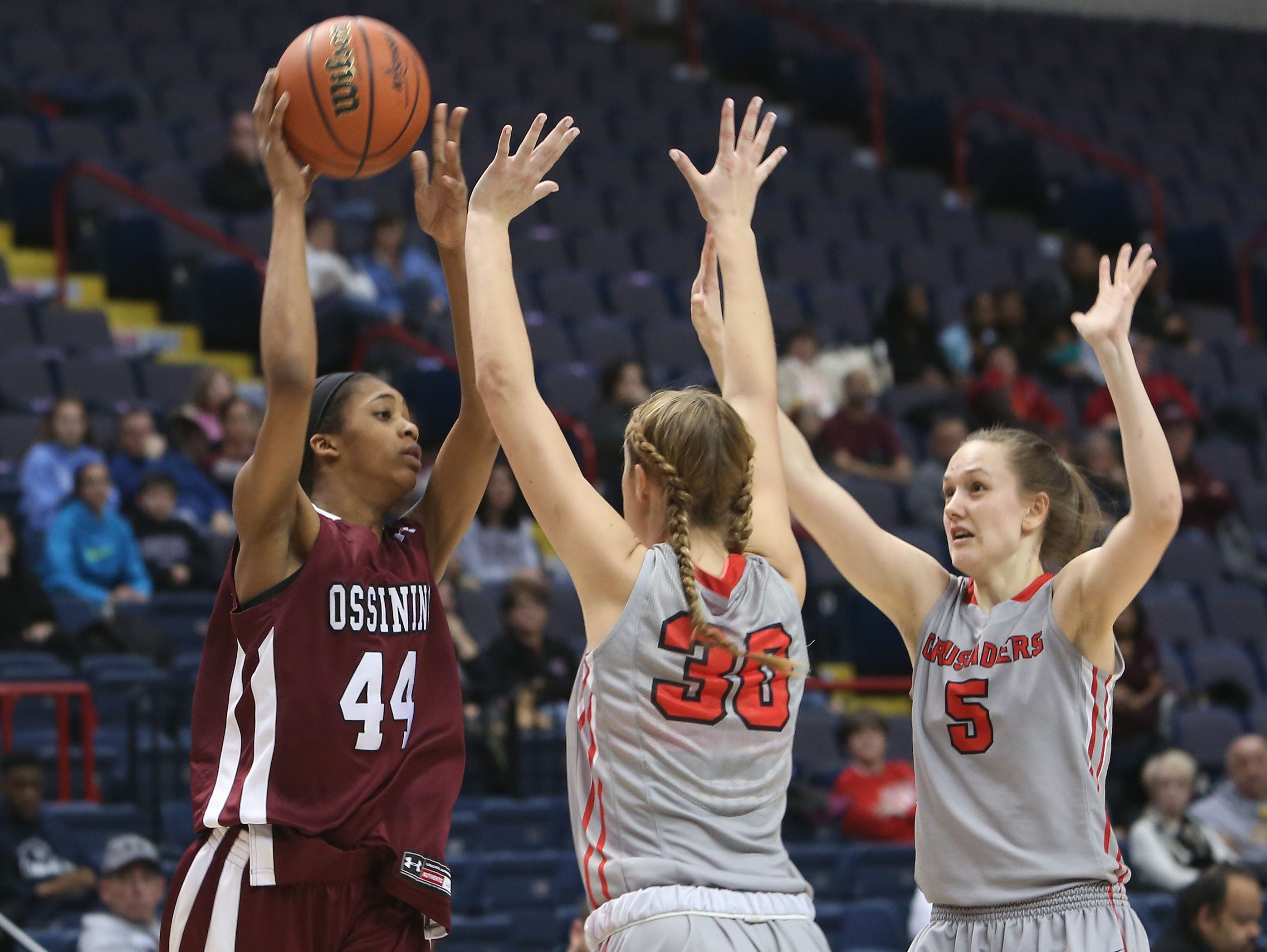 Ossining's Aubrey Griffin (44) looks for an open teammate against Long Island Lutheran's Jenna Siletti (33) during the girls Class A final of the New York State Federation Tournament of Champions at the Times Union Center in Albany March 18, 2016.
