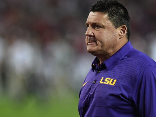 LSU coach Ed Orgeron walks across the field before the start of a game against Alabama on Nov 4, 2017, at Bryant-Denny Stadium.