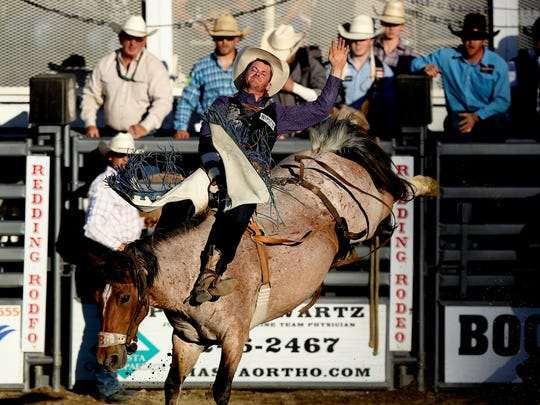 R.C. Landingham of Hat Creek competes in bareback riding during the Redding Rodeo.