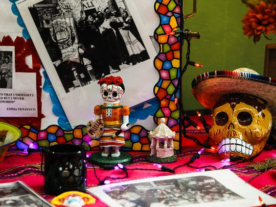Photos and figurines decorate the Emma Teneyuca ofrenda