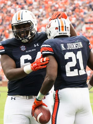 Auburn offensive lineman Mike Horton (64) celebrates with Auburn running back Kerryon Johnson (21) after Johnson scored his second touchdown during the NCAA football game between Auburn and Ole Miss on Saturday, Oct. 7, 2017, in Auburn, Ala.