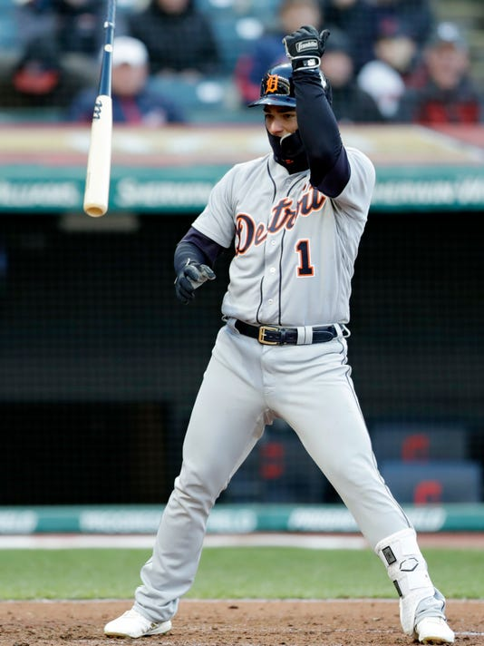 Detroit Tigers' Jose Iglesias throws his bat after striking out against Cleveland Indians starting pitcher Corey Kluber in the fifth inning of a baseball game, Monday, April 9, 2018, in Cleveland. (AP Photo/Tony Dejak)