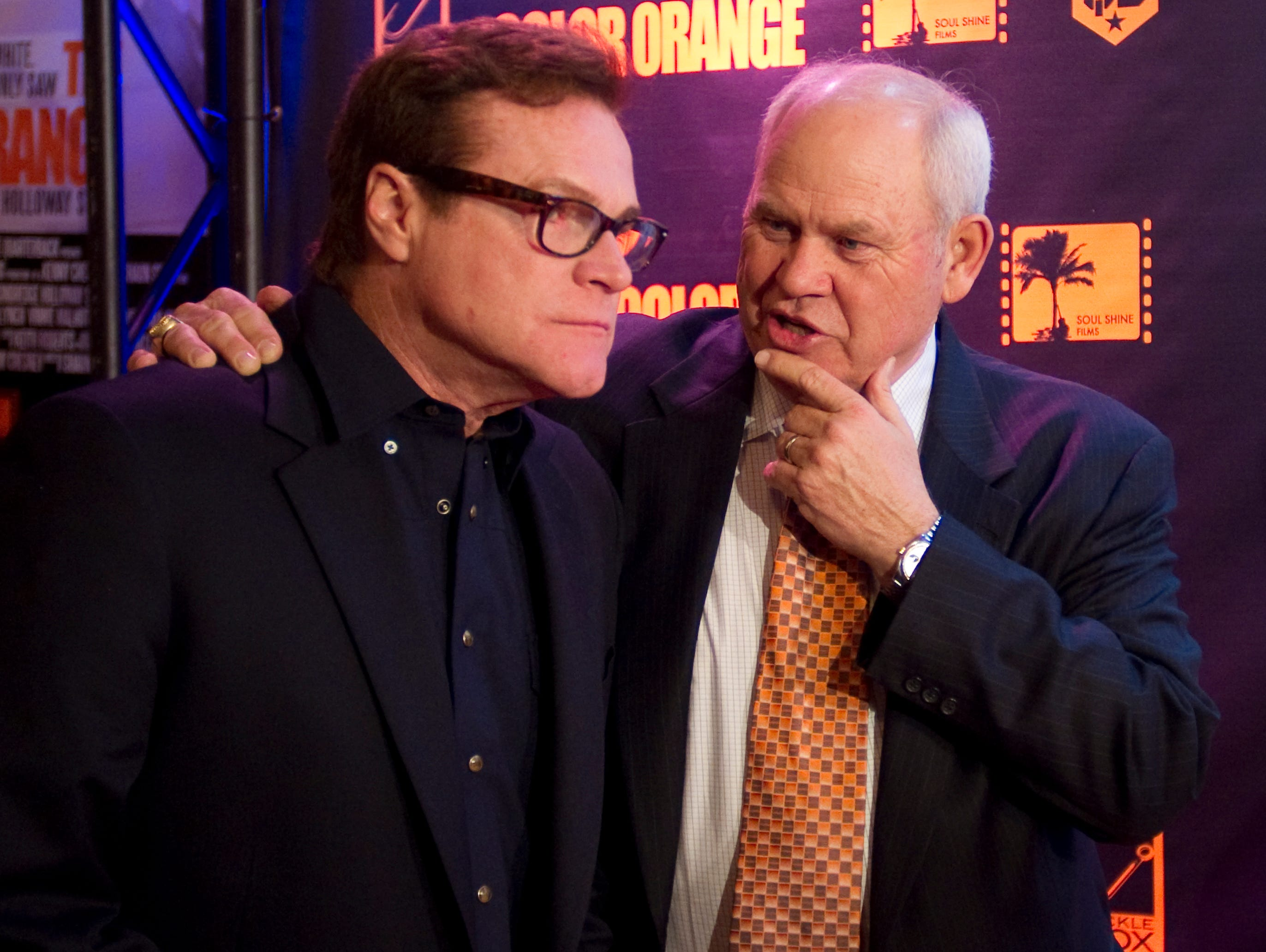 """Former Tennessee football coach Phillip Fulmer, right, chats with actor David Keith during the premier of """"The Color Orange: The Condredge Holloway Story"""" at the Tennessee Theatre on Feb. 16, 2011."""