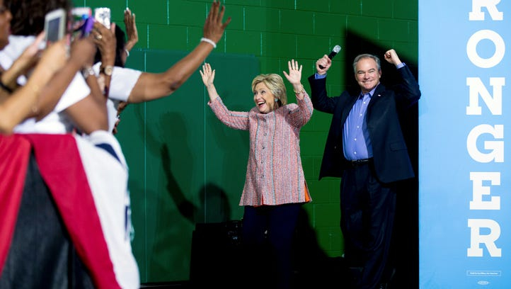 Hillary Clinton, accompanied by Sen. Tim Kaine, D-Va.,