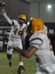 Smyrna quarterback John Turner fires a pass during