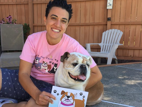 "Jaclene Santone is the author ""Cha Cha Gets Rescued."" She is pictured here with her English bulldog, who is the subject of her book."
