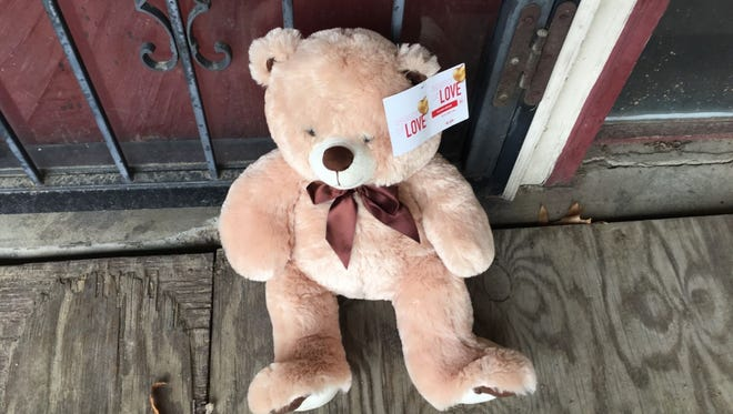A teddy bear was left outside of Alvin Hart's barbershop on Perkins.  Hart was shot and killed at a nearby Mexican restaurant Wednesday night.