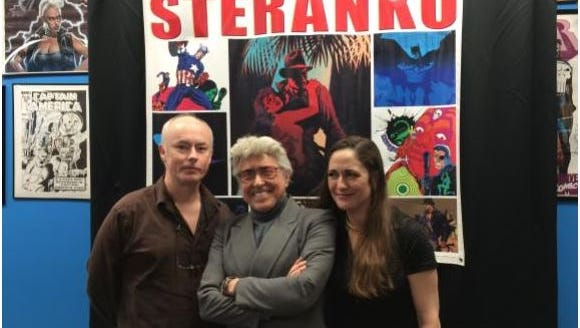 COMIC BOOK SHOP: David Spurlock (left) and Jim Steranko pose with a fan Saturday at The Comic Book Shop. Steranko is known for his work on Agent of S.H.I.E.L.D. and Nick Fury.