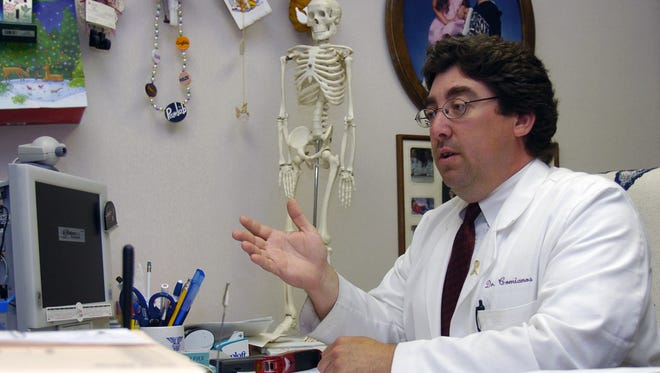 Marion County Coroner, Dr. Marc Comianos in a 2005 file photo.
