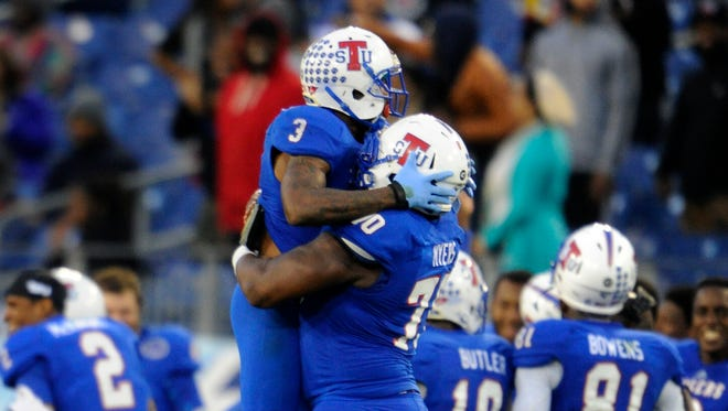 TSU guard Robert Myers lifts De'Ante Saunders to celebrate a 2013 victory over Murray State.