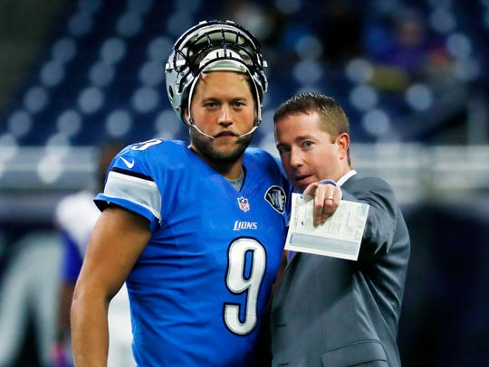 Lions quarterback Matthew Stafford talks with team