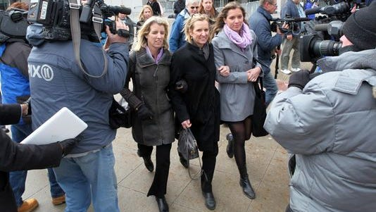 Surrounded by photographers, cameramen and reporters, Kerry Kennedy, center, walks from the Westchester County Courthouse during the lunch break in her DWI trial Feb. 26, 2014.