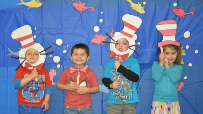 Kids turn themselves into Cats in the Hat at an event at Delaware Technical Community College that celebrated Dr. Seuss's birthday.