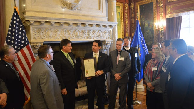 President of the Wisconsin Nursery and Landscape Association Ross Swartz (third from left)  accepts a proclamation from Gov. Scott Walker (center), commemorating the group's 100th Anniversary during a ceremony with WNLA board members January 3, 2018, at the State Capitol.