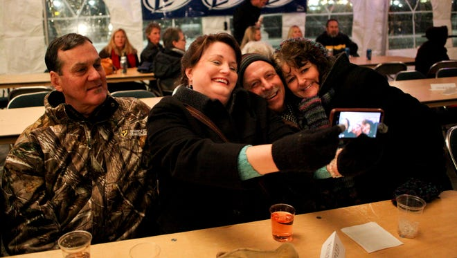 Tim and Lori Meikle, left, have their picture taken with Ken and Shelley Marzka during the 2013 Anchor Drop New Year's festivities at McMorran Place in downtown Port Huron