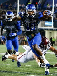 University of Memphis defender Shaun Rupert (front)