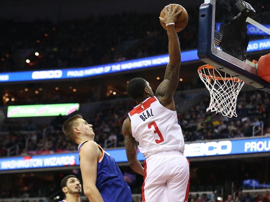 Washington Wizards guard Bradley Beal dunks the ball