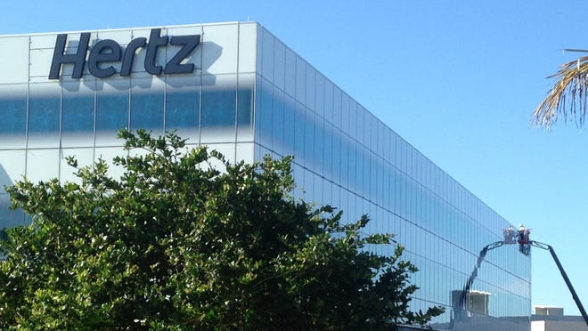 Corporate signage for Hertz on the company's new global headquarters in Estero.