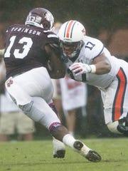 Auburn linebacker Kris Frost tackles Mississippi State
