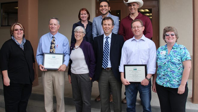 At a celebration at Southwest Bone & Joint Institute in Silver City, community members received certificates from U.S. Department of Agriculture New Mexico Rural Development. From left, in back are Melanie Goodman of Sen. Tom UdallÕs office, Gabe Vasquez of Sen. Martin HeinrichÕs office and Joe Baca of Congressman Steve PearceÕs office. In front are Kathy Barrett of the USDA NM RD Las Cruces Office, SWB&JI Operations Officer Mike McMillan, Silver City Small Business Development Center Director Jane Janson, USDA NM RD Director Terry Brunner, Silver City Mayor Mike Morones and state Economic Development Department area representative Christine Logan.