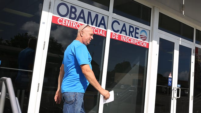 A customer walks out of the UniVista Insurance company office after shopping for a health plan under the Affordable Care Act.