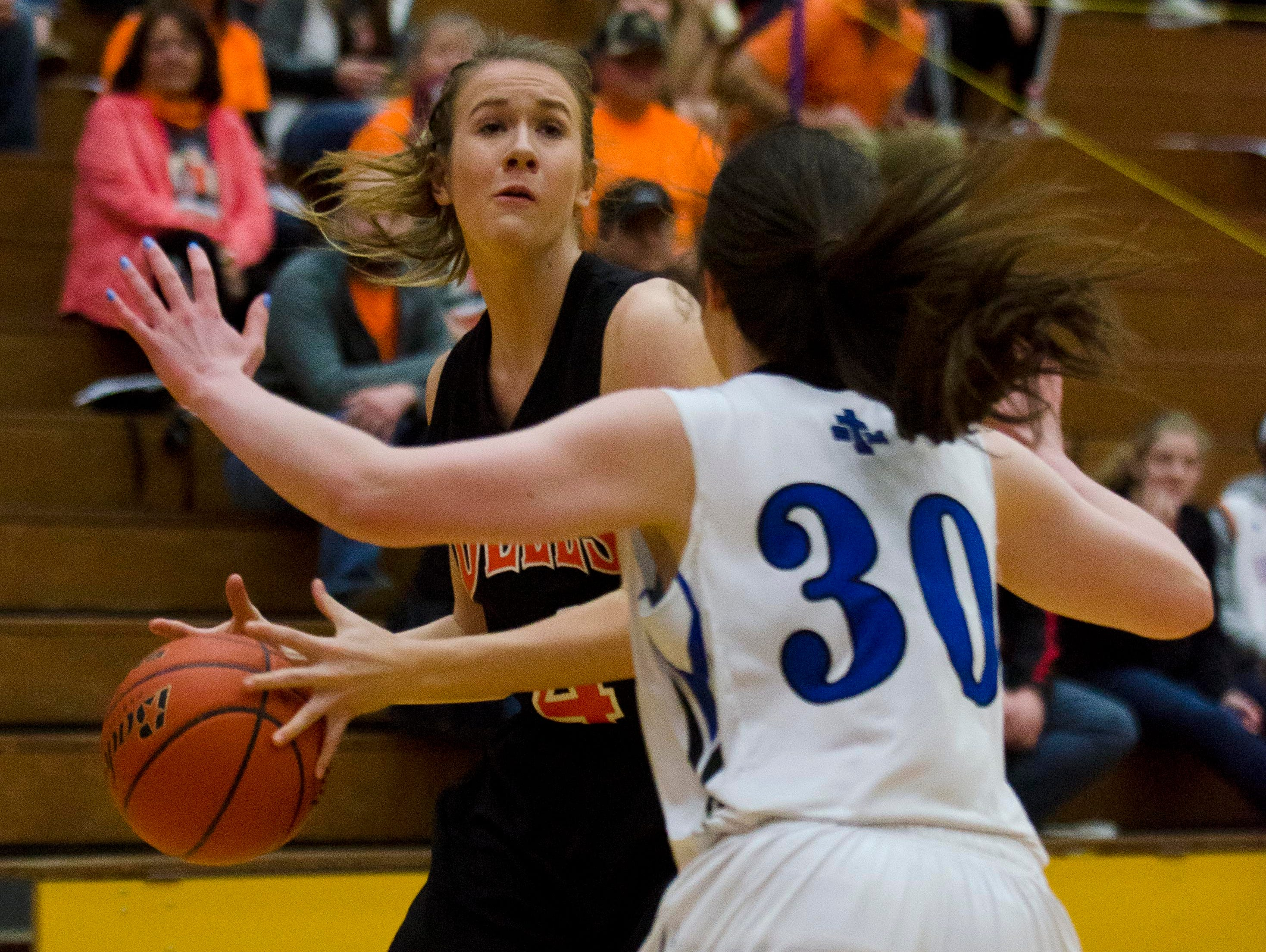 Aspen Hansen of Dell Rapids is defended by St. Thomas More's Shannon Duffy Thursday, March 10, in the Class A state quarterfinals at Watertown Civic Arena. Micah Bader/Dell Rapids Tribune