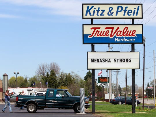 Kitz & Pfeil True Value Hardware in Menasha shows support for the victims of Sunday's shooting on the Trestle Trail bridge.