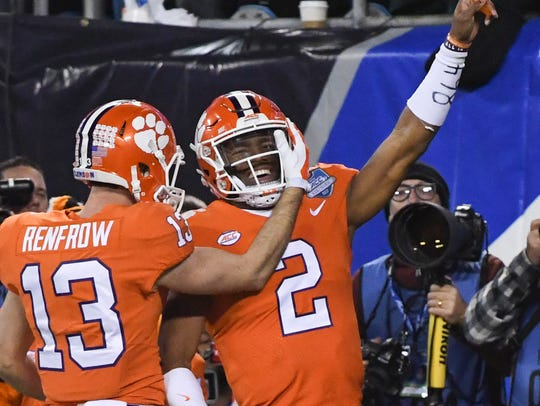 Clemson wide receiver Hunter Renfrow (13) hugs teammate