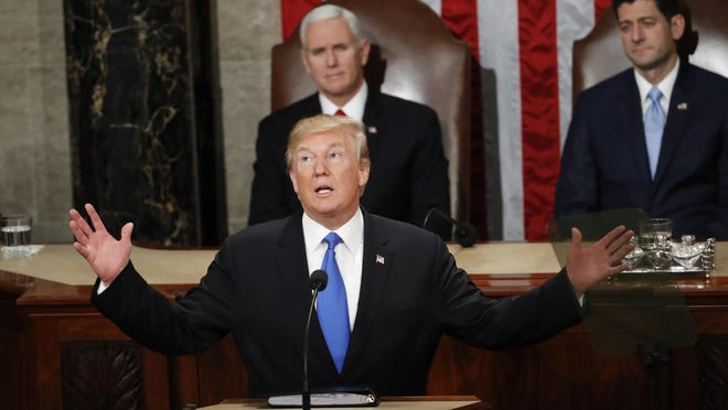 In this Jan. 30, 2018, photo, President Donald Trump delivers his State of the Union address to a joint session of Congress on Capitol Hill in Washington. Trump struck a variety of false notes in his big speech to Congress this past week and followed up with a curious coda _ a plain-as-your-face exaggeration about the TV audience that tuned in for it. (AP Photo/Pablo Martinez Monsivais)