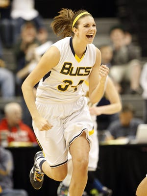 Grand Haven High's' Abby Cole celebrates after a basket against Grosse Pointe South during the fourth quarter of the State Class A Girls State Final on Saturday March 16, 2013 at the Breslin Center in East Lansing.