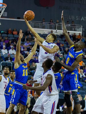 University of Evansville's Jaylon Brown (3) jumps up to put the ball in the basket and score against Morehead State during Saturday afternoon's game at the Ford Center.