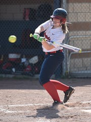 Slapping at the softball during Wednesday's opener