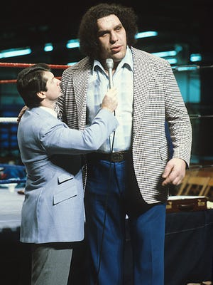 """Vince McMahon interview Andre the Giant in a scene from """"Andre Giant."""""""