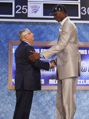 Former NBA Commissioner David Stern, left, poses with Connecticut's Hasheem Thabeet, who was picked by the Memphis Grizzlies with the second overall selection during the first round of the 2009 draft.